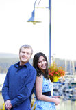 Interracial couple standing by boat pier Stock Photo