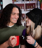 Interracial couple toasting with coffee cups Stock Images