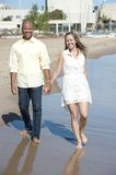 Interracial couple walking Royalty Free Stock Images