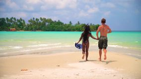 Interracial happy couple enjoy honeymoon on the tropical beach at sunny summer day. Interracial couple white Caucasian man and tanned Asian girl close-up on stock video footage