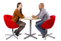 Interracial Date. Interracial couple on a casual coffeeshop date royalty free stock image