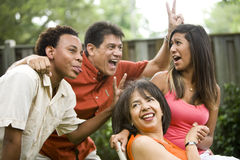 Interracial family. Making silly gestures posing for photograph royalty free stock images