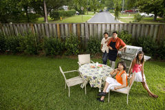 Interracial family in backyard royalty free stock images