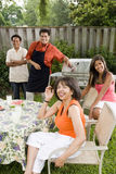 Interracial family in backyard Stock Photos