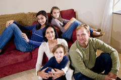 Interracial family of five relaxing at home Royalty Free Stock Photo