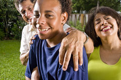 Interracial family, Hispanic and African American. Interracial family, portrait of African teenage boy with proud parents Royalty Free Stock Photos