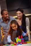 Interracial family at home playing smiling Royalty Free Stock Images
