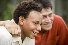 Interracial father and son stock images