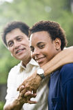 Interracial father and teenage son stock photography