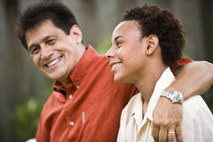 Interracial father and teenage son stock images