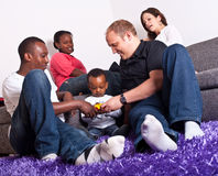 Interracial friends and family. Young group of multiracial friends - two young families enjoying Royalty Free Stock Photography