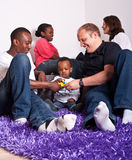 Interracial friends and family. Young group of multiracial friends - two young families enjoying stock photos