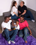 Interracial friends and family. Young group of multiracial friends - two young families enjoying Stock Photography