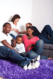 Interracial friends and family. Young group of multiracial friends - two young families enjoying stock photo