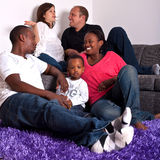 Interracial friends and family. Young group of multiracial friends - two young families enjoying royalty free stock images