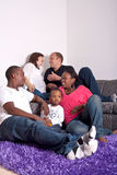 Interracial friends and family. Young group of multiracial friends - two young families enjoying the afternoon Royalty Free Stock Image