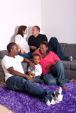 Interracial friends and family. Young group of multiracial friends - two young families enjoying the afternoon Stock Photography