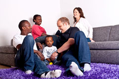 Interracial friends and family. Young group of multiracial friends - two young families enjoying the afternoon Stock Photo