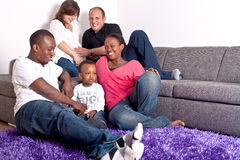 Interracial friends and family. Young group of multiracial friends - two young families enjoying the afternoon Stock Photos