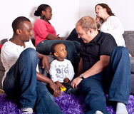 Interracial friends and family. Young group of multiracial friends - two young families enjoying the afternoon stock image
