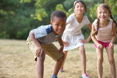 Interracial group of kids in summer. Having fun royalty free stock image