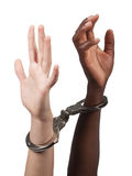 Interracial handcuffed. Caucasian man and African American woman handcuffed together Stock Photos