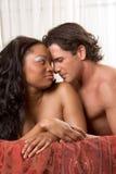 Interracial heterosexual sensual couple in love Stock Images