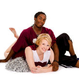 Interracial High School Football Cheer Couple. A Teenage Cheer Leader with Football Player Stock Photo
