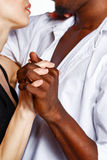 Interracial love. Multiracial cute couple hugging each other passionately Stock Photography