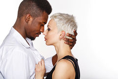 Interracial love. Multiracial cute couple hugging each other passionately Royalty Free Stock Photos