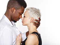 Interracial love. Multiracial cute couple hugging each other passionately Royalty Free Stock Image