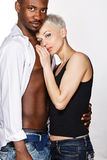 Interracial love. Multiracial cute couple hugging each other passionately Royalty Free Stock Photography