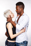 Interracial love. Multiracial cute couple hugging each other passionately Stock Photo