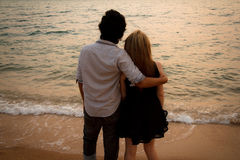 Interracial lover Couple huging on the beach Stock Images