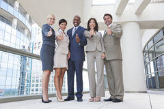 Interracial Men & Women Business Team Thumbs Up Royalty Free Stock Photo