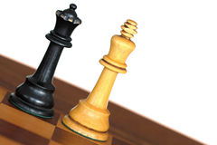 Interracial relationship. Queen and King chess pieces on board on white background Stock Photography