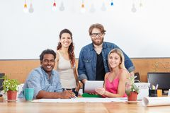 Interracial startup group as a team. In business meeting Royalty Free Stock Image