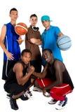 Interracial team van het Basketbal Stock Afbeeldingen