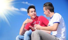 Interracial teenage boys talking stock photos