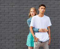Interracial young couple in love outdoor. Stunning sensual outdoor portrait of young stylish fashion couple posing in summer. Girl. Interracial very young couple Royalty Free Stock Photo