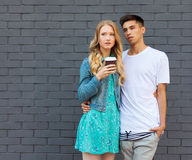 Interracial young couple in love outdoor. Stunning sensual outdoor portrait of young stylish fashion couple posing in summer. Girl. Interracial very young couple royalty free stock image