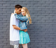 Interracial young couple in love outdoor. Stunning sensual outdoor portrait of young stylish fashion couple posing in summer. Girl. Interracial very young couple Royalty Free Stock Images