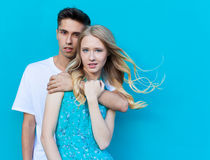 Interracial young couple in love outdoor. Stunning sensual outdoor portrait of young stylish fashion couple posing in summer. Guyh Royalty Free Stock Photography