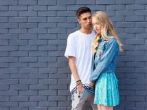 Interracial young couple in love outdoor. Stunning sensual outdoor portrait of young stylish fashion couple posing in summer. Hisp. Interracial very young couple Royalty Free Stock Photo
