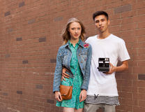 Interracial young couple in love outdoor. Stunning sensual outdoor portrait of young stylish fashion couple posing in summer. Man. Interracial very young couple Royalty Free Stock Photo