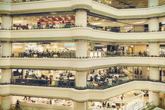 Shopping mall. Inside busy city retail shopping mall center with fashion stores and shops. People shopping in shop and store. Interior of modern business Stock Photos