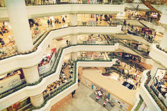 Shopping center. Inside busy city retail shopping mall center with fashion stores and shops. People shopping in shop and store. Interior of modern business Royalty Free Stock Photo