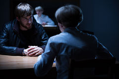 Interrogation in a dark room Royalty Free Stock Photo