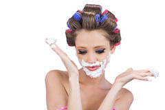 Interrogative woman posing with shaving foam Stock Images