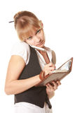 Interrupted businesswoman. Interrupted serious businesswoman with mobile phone and notepad Stock Photography